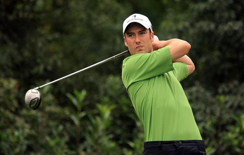 SHANGHAI, CHINA - NOVEMBER 08:  Ross Fisher of England watches his tee shot on the 5th hole during the second round of the HSBC Champions at Sheshan International Golf Club on November 8, 2008 in Shanghai, China.  (Photo by Scott Halleran/Getty Images)