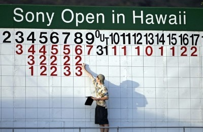 A volunteer changes numbers on the scoreboard off the 18th green during the first round of the Sony Open held at the Waialae Country Club, Thursday, Jan. 11 2006 in Honolulu.  (Marco Garcia/wireimage.com) PGA TOUR - 2007 Sony Open - First RoundPhoto by Marco Garcia/WireImage.com