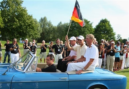 MUNICH, GERMANY - JUNE 22:  Martin Kaymer of Germany holds the german flag whilst seated in an BMW oldtimer along with Anders Hansen of Denmark and Stephan Gross Junior of Germany after the final round of The BMW International Open Golf at The Munich North Eichenried Golf Club on June 22, 2008, in Munich, Germany.  (Photo by Stuart Franklin/Getty Images)