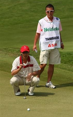 BANGKOK, THAILAND - JANUARY 10:  Toru Taniguchi of Japan lines up a putt during the fourball match on Day two of The Royal Trophy at the Amata Spring Country Club on January 10, 2009 in Bangkok, Thailand.  (Photo by Ian Walton/Getty Images)