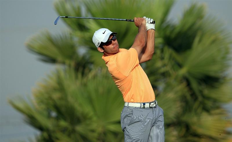 BAHRAIN, BAHRAIN - JANUARY 29:  Paul Casey of England plays his second shot to the 18th hole during the third round of the 2011 Volvo Champions held at the Royal Golf Club on January 29, 2011 in Bahrain, Bahrain.  (Photo by David Cannon/Getty Images)