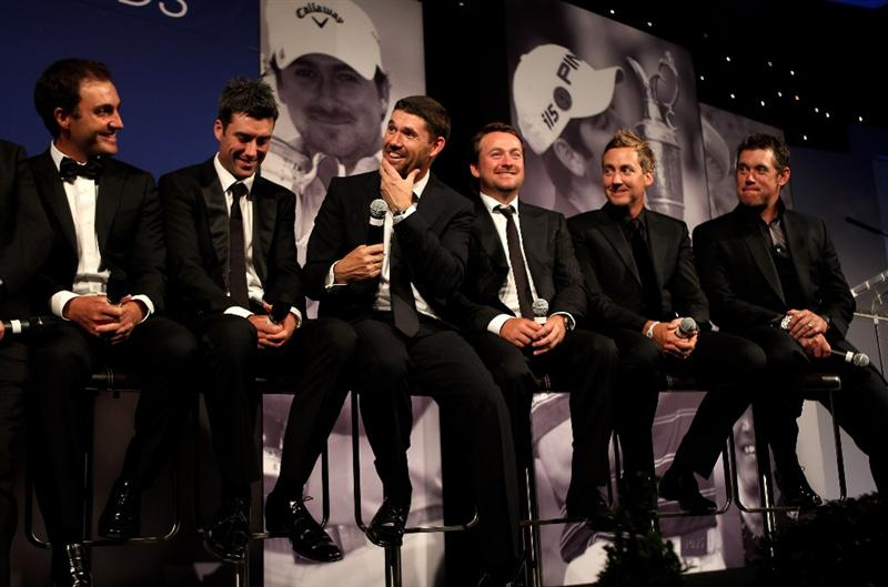 VIRGINIA WATER, ENGLAND - MAY 24: (L-R)  Edoardo Molinari, Ross Fisher, Padraig Harrington, Graeme McDowell, Ian Poulter and Lee Westwood of the 2010 European Ryder Cup team speak on stage during the European Tour Dinner at The Wentworth Club on May 24, 2011 in Virginia Water, England.  (Photo by Andrew Redington/Getty Images)