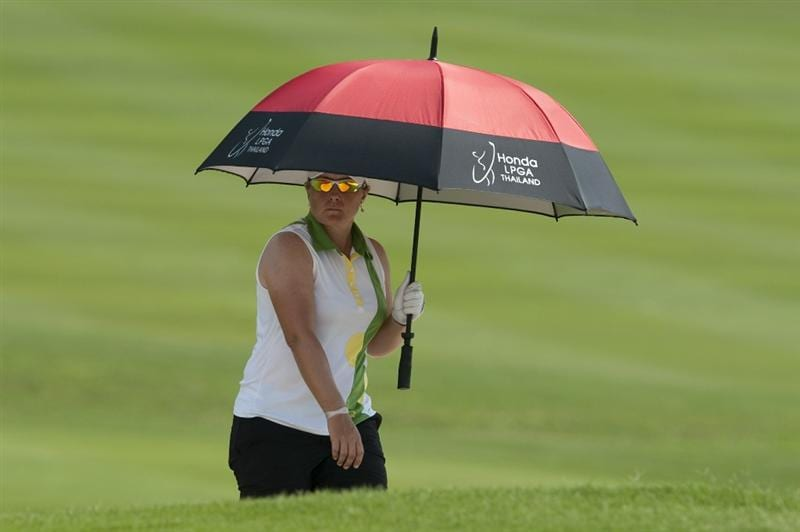 CHON BURI, THAILAND - FEBRUARY 19:  Karen Stupples of England shelters from the sun under an umbrella on the 18th hole during day three of the LPGA Thailand at Siam Country Club on February 19, 2011 in Chon Buri, Thailand.  (Photo by Victor Fraile/Getty Images)