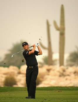 DOHA, QATAR - JANUARY 26:  Nick Dougherty of England hits his third shot on the ninth hole during the third round of the Commercialbank Qatar Masters at Doha Golf Club on January 26, 2008 in Doha, Qatar.  (Photo by Andrew Redington/Getty Images)