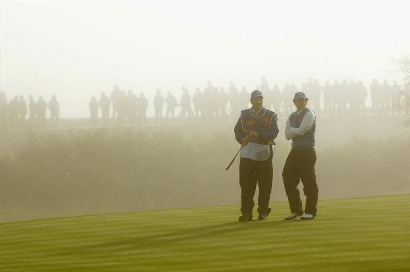 NEWPORT, WALES - OCTOBER 04:  Rory McIlroy of Europe waits with his caddie J.P. Fitzgerald on the third green in the singles matches during the 2010 Ryder Cup at the Celtic Manor Resort on October 4, 2010 in Newport, Wales.  (Photo by Andrew Redington/Getty Images)