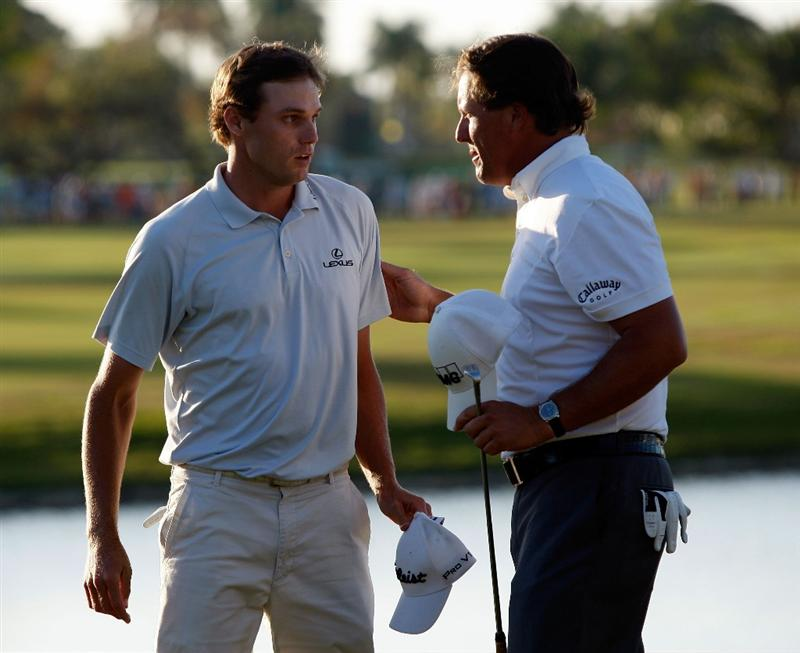 DORAL, FL - MARCH 15:  Nick Watney congratulates Phil Mickelson after Mickelson won the World Golf Championships-CA Championship on March 15, 2009 at the Doral Golf Resort and Spa in Doral, Florida.  (Photo by Jamie Squire/Getty Images)