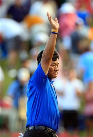 PONTE VEDRA BEACH, FL - MAY 15:  K.J. Choi of South Korea celebrates making a par-saving putt to defeat David Toms on the first playoff hole during the final round of THE PLAYERS Championship held at THE PLAYERS Stadium course at TPC Sawgrass on May 15, 2011 in Ponte Vedra Beach, Florida.  (Photo by Sam Greenwood/Getty Images)