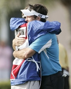 Mark Wilson is congratulated by his caddie, Chris Jones, after winning the Honda Classic on the Champion Course at PGA National in Palm Beach Gardens, Florida on Monday, March 5, 2007. PGA TOUR - The 2007 Honda Classic - Playoff Continuation - March 5, 2007Photo by Sam Greenwood/WireImage.com