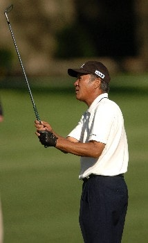 Isao Aoki watches his second shot on the 15th hole during the second round of the Champions' Tour 2005 SBC Classic at  the Valencia Country Club in Valencia, California March 12, 2005.