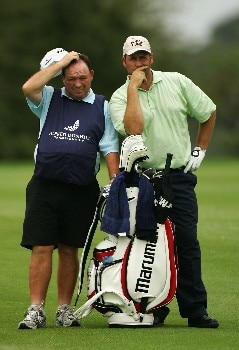 MALELANE, SOUTH AFRICA - DECEMBER 09:  John Bickerton of England waits with his caddie to play his second shot into the second green during the final round of The Alfred Dunhill Championship at The Leopard Creek Country Club on December 9, 2007 in Malelane, South Africa.  (Photo by Warren Little/Getty Images)