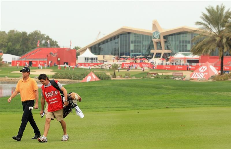 ABU DHABI, UNITED ARAB EMIRATES - JANUARY 20:  Anders Hansen of Denmark walks with his caddie Nick Mumford on the first hole during the first round of The Abu Dhabi HSBC Golf Championship at Abu Dhabi Golf Club on January 20, 2011 in Abu Dhabi, United Arab Emirates.  (Photo by Andrew Redington/Getty Images)