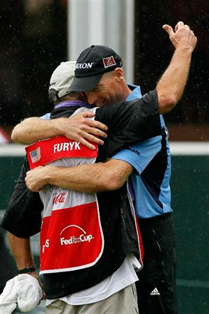 ATLANTA - SEPTEMBER 26:  Jim Furyk and caddie Mike 'Fluff' Cowan celebrate Furyk winning the FedExCup and THE TOUR Championship presented by Coca-Cola, the final event of the PGA TOUR Playoffs for the FedExCup, at East Lake Golf Club on September 26, 2010 in Atlanta, Georgia.  (Photo by Kevin C. Cox/Getty Images)