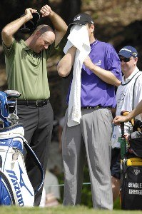 Stewart Cink, left and J.J. Henry of the USA seek a little relief from the heat during the second round of the WGC-Barbados World Cup held on the Country Club Course at the Sandy Lane Resort in St. James, Barbados, on December 8, 2006. PGA TOUR - WGC - 2006 Barbados World Cup - Second RoundPhoto by Steve Levin/WireImage.com