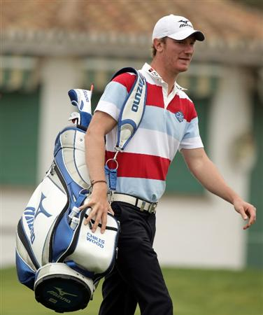 MALAGA, SPAIN - MARCH 23:  Chris Wood of England carries his bag on to the first tee during the pro-am event prior to the Open de Andalucia at the Parador de Malaga Golf on March 23, 2011 in Malaga, Spain.  (Photo by Ross Kinnaird/Getty Images)