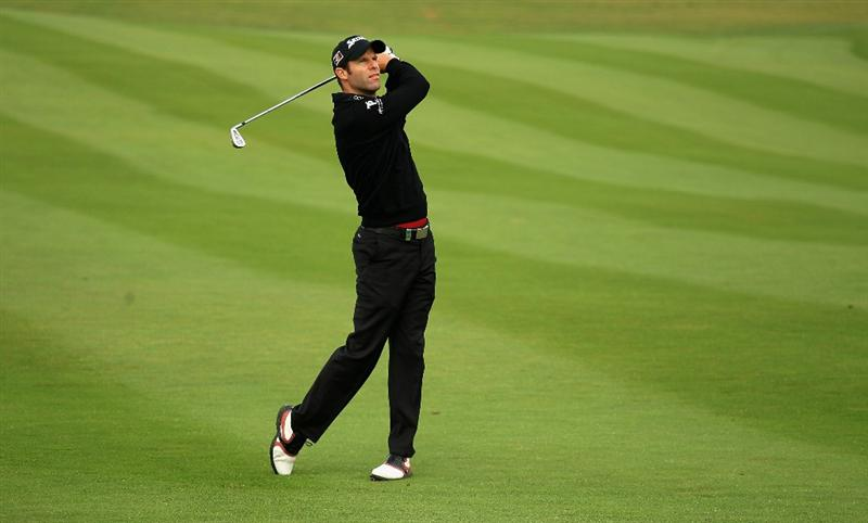 NEWPORT, WALES - JUNE 02:  Bradley Dredge of Wales plays his second shot into the third green during the Pro-Am for the Celtic Manor Wales Open on The Twenty Ten Course on June 2, 2010 in Newport, Wales.  (Photo by Warren Little/Getty Images)