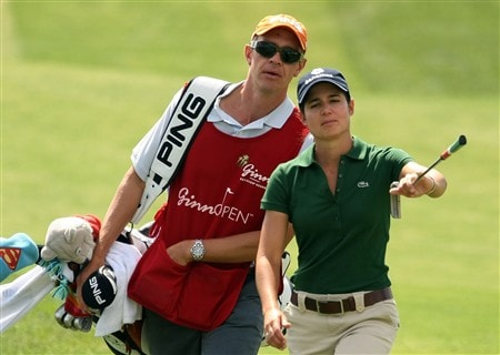 REUNION, FLORIDA - APRIL 17:  Lorena Ochoa (R) of Mexico walks with her caddie Dave Brooker to the first green during the first round of the Ginn Open at Reunion Resort April 17, 2008 in Reunion, Florida.  (Photo by Scott Halleran/Getty Images)