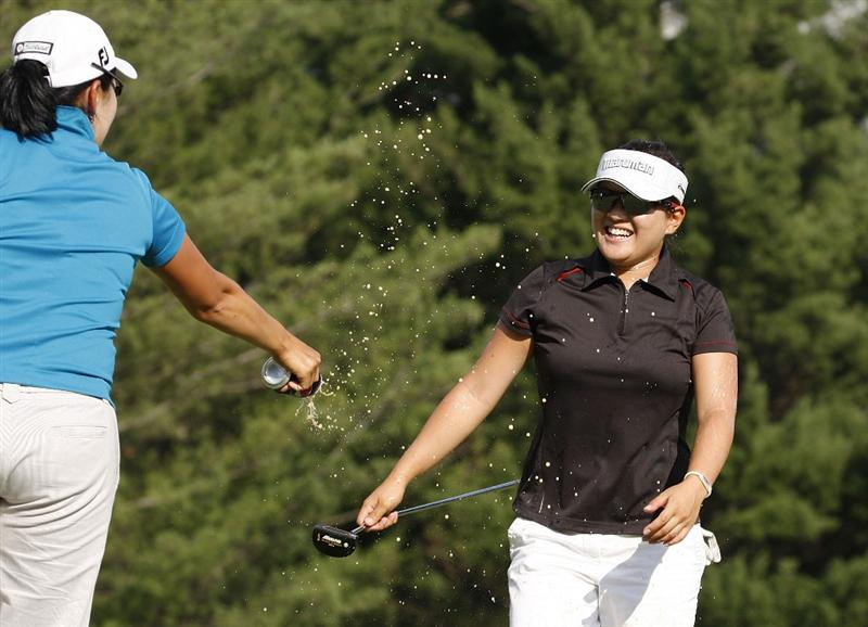 SYLVANIA, OH - JULY 05:  Eunjung Yi of South Korea celebrates on the 18th green with fellow player Jimin Jeong after winning the Jamie Farr Owens Corning Classic at Highland Meadows Golf Club on July 5, 2009 in Sylvania, Ohio. Yi made a birdie on the first playoff hole to beat Morgan Pressel. (Photo by Gregory Shamus/Getty Images)
