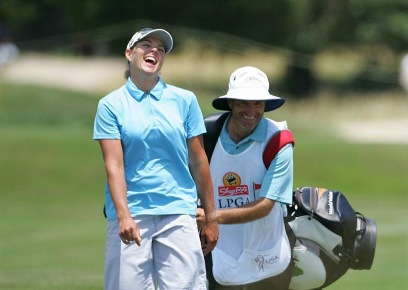 GALLOWAY, NJ - JUNE 19:  Katherine Hull (L) of Australia shares a laugh with her caddie as they walk down the fairway during the second round of the ShopRite LPGA Classic held at Dolce Seaview Resort (Bay Course) on June 19, 2010 in Galloway, New Jersey.  (Photo by Michael Cohen/Getty Images)