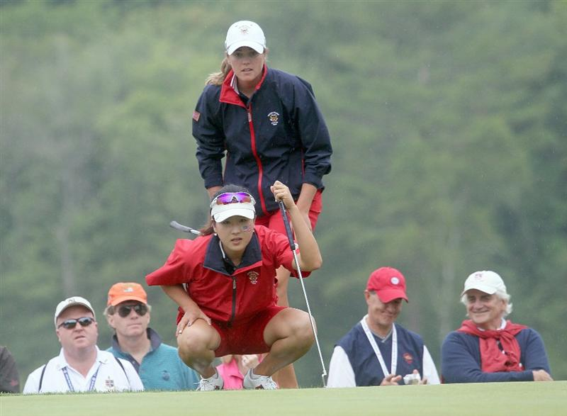MANCHESTER, MA - JUNE 12:  Cydney Clanton (top) and Jennifer Song of the United States line up a putt in Four Ball competition during the second day of the 2010 Curtis Cup Match at the Essex Country Club on June 12, 2010 in Manchester, Massachusetts. (Photo by Jim Rogash/Getty Images)