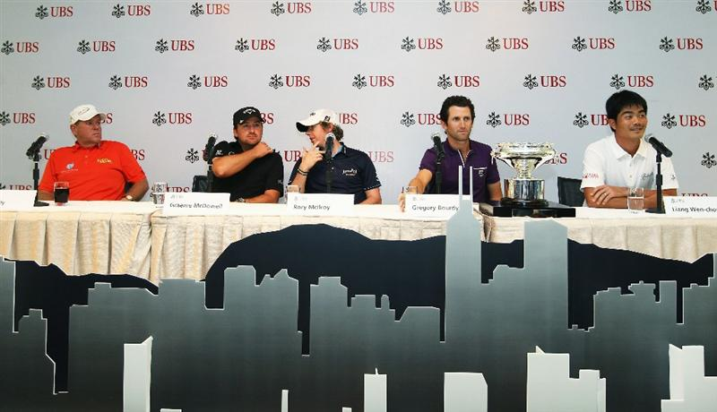 HONG KONG - NOVEMBER 16:  Gregory Bourdy of France, Graeme McDowell, Rory McIlroy of Northern Ireland and John Daly of the United States speaks to the press during the UBS Hong Kong Open Press Conference at the International Finance Centre on November 16, 2010 in Hong Kong, Hong Kong.  (Photo by Ian Walton/Getty Images)