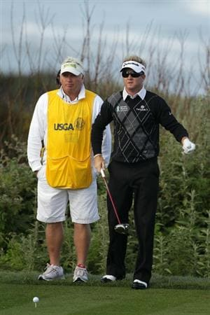 PEBBLE BEACH, CA - JUNE 17:  Brian Gay and his caddie Kim Henley II look on from the tee on the 11th hole during the first round of the 110th U.S. Open at Pebble Beach Golf Links on June 17, 2010 in Pebble Beach, California.  (Photo by Andrew Redington/Getty Images)