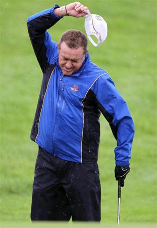 NEWPORT, WALES - SEPTEMBER 29:  Miguel Angel Jimenez of Europe reacts during a practice round prior to the 2010 Ryder Cup at the Celtic Manor Resort on September 29, 2010 in Newport, Wales.  (Photo by Andy Lyons/Getty Images)