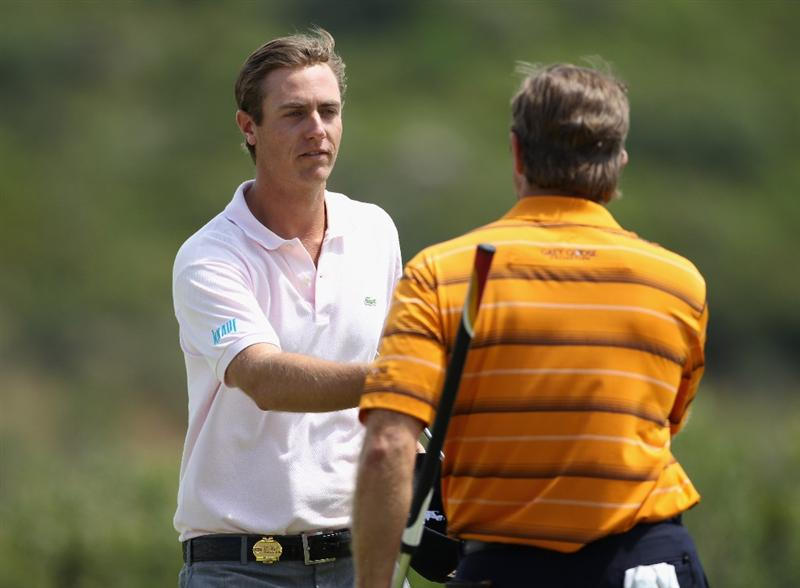 CASARES, SPAIN - MAY 20:  Nicolas Colsaerts of Belgium (left) shakes hands with Retief Goosen of South Africa after winning their match during the group stages of the Volvo World Match Play Championship at Finca Cortesin on May 20, 2011 in Casares, Spain.  (Photo by Andrew Redington/Getty Images)