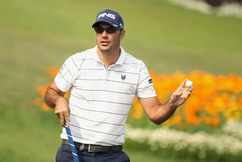 NEW DELHI, INDIA - FEBRUARY 20:  Gregory Havret of France celebrates on the 18th green during the fourth round of the Avantha Masters held at The DLF Golf and Country Club on February 20, 2011 in New Delhi, India.  (Photo by Ian Walton/Getty Images)