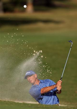 BOCA RATON, FL - FEBRUARY 14:  Mike Goodes hits a shot out of the greenside bunker on the 18th hole during the second round of the Allianz Championship at The Old Course at Broken Sound Club on February 14, 2009 in Boca Raton, Florida.  (Photo by Doug Benc/Getty Images)