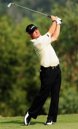 SHENZHEN, GUANGDONG - NOVEMBER 25:  Alex Cejka of Germany plays a shot during pro - am the Omega Mission Hills World Cup on the Olazabal course on November 25, 2009 in Shenzhen, China.  (Photo by Stuart Franklin/Getty Images)