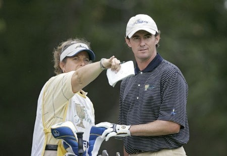 Mark Hensby of the International team with his caddie Fanny Sunneson during the four-ball matches in the third round of The Presidents Cup at Robert Trent Jones Golf Club in Prince William County, Virginia on September 24, 2005.Photo by Sam Greenwood/WireImage.com
