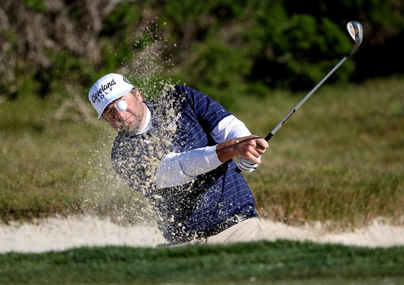 PEBBLE BEACH, CA - FEBRUARY 12:  Steve Marino hits from a bunker on the 11th hole at the AT&T Pebble Beach National Pro-Am- Round Three at the Monterey Peninsula country club on February 12, 2011 in Pebble Beach, California. (Photo by Jed Jacobsohn/Getty Images)