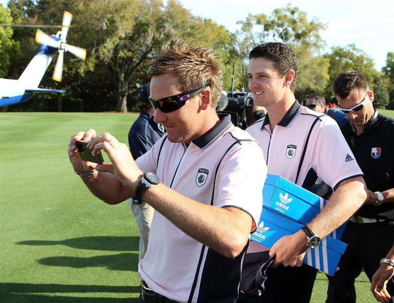 ORLANDO, FL - MARCH 14:  Ian Poulter (L) and Justin Rose of England arrive by helicopter prior to the first day of the Tavistock Cup at Isleworth Country Club on March 14, 2011 in Orlando, Florida.  (Photo by Sam Greenwood/Getty Images)