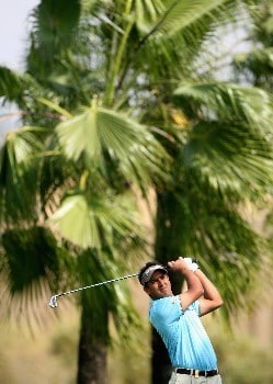 DUBAI, UNITED ARAB EMIRATES - FEBRUARY 03:  Shiv Kapur of India hits his second shot on the fifth hole during the final round of the Dubai Desert Classic, on the Majilis Course at the Emirates Golf Club, on February 3, 2008 in Dubai, United Arab Emirates.  (Photo by Andrew Redington/Getty Images)