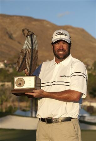 SAN JACINTO, CA - OCTOBER 04: Jerod Turner poses with the winner's trophy after winning the 2009 Soboba Classic at The Country Club at Soboba Springs on October 4, 2009 in San Jacinto, California. (Photo by Robert Laberge/Getty Images)
