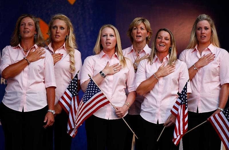 SUGAR GROVE, IL - AUGUST 20:  (L-R) Angela Stanford, Natalie Gulbis, Morgan Pressel, Beth Daniel, Kristy McPherson and Brittany Lincicome of the U.S. Team listen to the national anthem during the Opening Ceremonies prior to the start of the 2009 Solheim Cup at Rich Harvest Farms on August 20, 2009 in Sugar Grove, Illinois.  (Photo by Scott Halleran/Getty Images)