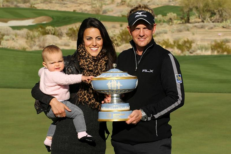 MARANA, AZ - FEBRUARY 27:  Luke Donald of England (R), his wife Diane and daughter Elle celebrate with The Walter Hagen Cup trophy after winning his match 3-up on the 16th hole during the final round of the Accenture Match Play Championship at the Ritz-Carlton Golf Club on February 27, 2011 in Marana, Arizona.  (Photo by Andy Lyons/Getty Images)