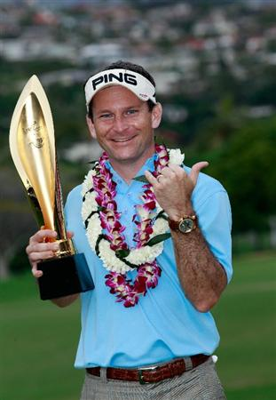HONOLULU, HI - JANUARY 16:  Mark Wilson poses with the trophy after winning the Sony Open at Waialae Country Club on January 16, 2011 in Honolulu, Hawaii.  (Photo by Sam Greenwood/Getty Images)