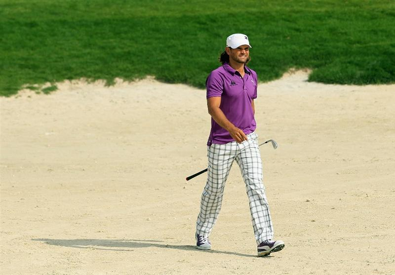 BAHRAIN, BAHRAIN - JANUARY 29:  Johan Edfors of Sweden walks to the green after his second shot on the ninth hole during the third round of the Volvo Golf Champions at The Royal Golf Club on January 29, 2011 in Bahrain, Bahrain.  (Photo by Andrew Redington/Getty Images)