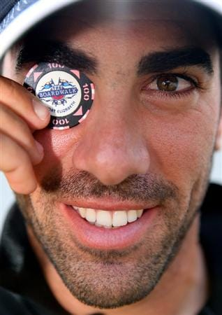 CASTELLO, SPAIN - OCTOBER 24:  Alvaro Quiros of Spain poses with his lucky poker chip that he uses as a ball marker after the second round of the Castello Masters Costa Azahar at the Club de Campo del Mediterraneo on October 24, 2008 in Castello, Spain.  (Photo by Stuart Franklin/Getty Images)