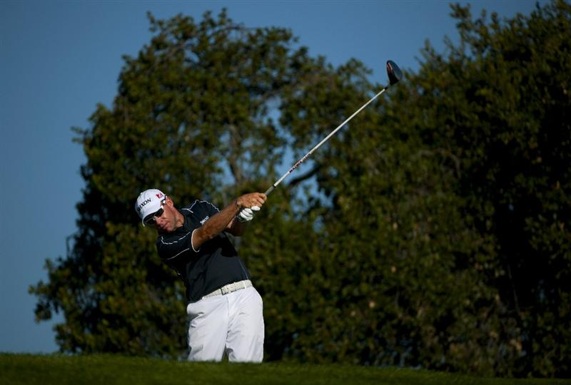 SAN MARTIN, CA - OCTOBER 14:  Brian Davis makes a tee shot on the 18th hole during the first round of the Frys.com Open at the Corde Valle Country Club on October 14, 2010 in San Martin, California.  (Photo by Robert Laberge/Getty Images)