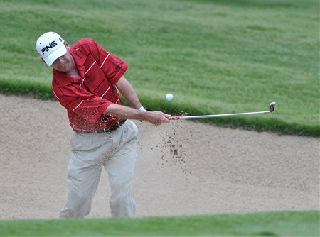 FORT WORTH , TX - MAY 24:  Kevin Sutherland blasts out of the greenside bunker on the 1st hole during the third round of the Crowne Plaza Invitational at Colonial Country Club on May 24, 2008 in Fort Worth, Texas.  (Photo by Marc Feldman/Getty Images)