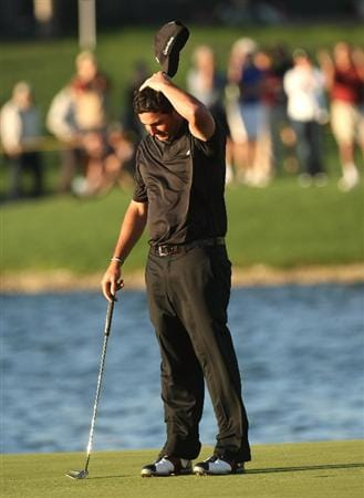 LA QUINTA, CA - JANUARY 25:  Pat Perez reacts after sinking the final putt for a three stroke victory on the Palmer Private course at PGA West during the final round of the Bob Hope Chrysler Classic on January 25, 2009 in La Quinta, California.  (Photo by Stephen Dunn/Getty Images)