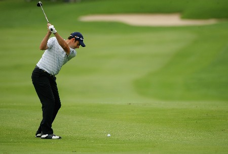 MALELANE, SOUTH AFRICA - DECEMBER 08:  Richard Bland of England plays his second shot into the 13th green during the third round of The Alfred Dunhill Championship at The Leopard Creek Country Club on December 8, 2007 in Malelane, South Africa.  (Photo by Warren Little/Getty Images)