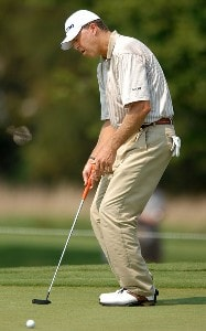Bob Tway reacts to a missed birdie putt on the ninth green during the first round of the Wyndham Championship at Forest Oaks Country Club on August 16, 2007 in Greensboro, North Carolina. PGA TOUR - 2007 Wyndham Championship - First RoundPhoto by Jonathan Ernst/WireImage.com