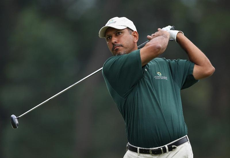 HONG KONG, CHINA - NOVEMBER 22:  Jeev Milkha Singh of India plays his tee shot on the 13th hole during the third round of the UBS Hong Kong Open at the Hong Kong Golf Club on November 22, 2008 in Fanling, Hong Kong.  (Photo by Stuart Franklin/Getty Images)