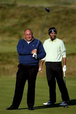 KINGSBARNS, SCOTLAND - OCTOBER 04:  Andrew 'Chubby' Chandler and Abdullah Al Naboodah on the fifth hole during the third round of The Alfred Dunhill Links Championship at Kingsbarns Golf Links on October 4, 2009 in Kingsbarns, Scotland.The third round was postponed on Saturday due to gale force winds.  (Photo by Andrew Redington/Getty Images)