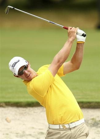 MELBOURNE, AUSTRALIA - NOVEMBER 14:  Steve Jones of Australia hits a ball out of the bunker during round four of the Australian Masters at The Victoria Golf Club on November 14, 2010 in Melbourne, Australia.  (Photo by Lucas Dawson/Getty Images)