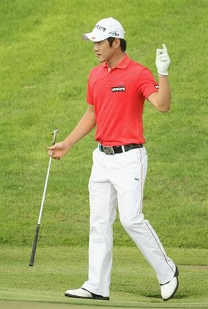 SINGAPORE - NOVEMBER 14:  Kang Kyung-nam of Korea celebrates a shot on the 2nd green during the Final Round of the Barclays Singapore Open at Sentosa Golf Club on November 14, 2010 in Singapore, Singapore.  (Photo by Ian Walton/Getty Images)