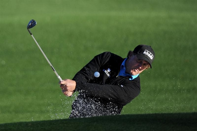 AUGUSTA, GA - APRIL 06:  Phil Mickelson plays a bunker shot during a practice round prior to the 2011 Masters Tournament at Augusta National Golf Club on April 6, 2011 in Augusta, Georgia.  (Photo by Harry How/Getty Images)